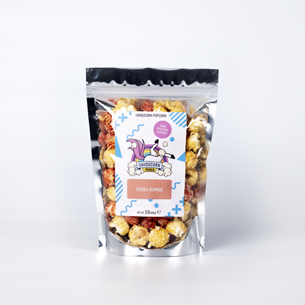 Tequila Sunrise popcorn in a pouch. the popcorn is red and yellow and the logo is a Unicorn upside down and says Uniqucorn-tails Underneath