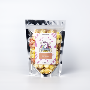 A pouch of colourful popcorn on a white background. The popcorn is different shades of yellow and orange and the pouch is labelled with a Unicorn logo and named Tropical Mix